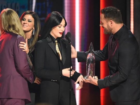 "Kacey Musgraves accepts the award for Best Album of the Year for ""Golden Hour"" from Little Big Town during the 52nd Annual CMA Awards at Bridgestone Arena Wednesday Nov. 14, 2018, in Nashville, Tenn."