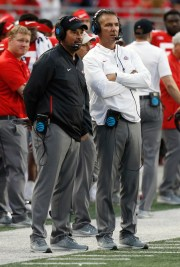 Ohio Urban Meyer head coach, right, and offensive coordinator Ryan Day watch from the sidelines against Tulane during the second half in Columbus, Ohio, September 22, 2018.