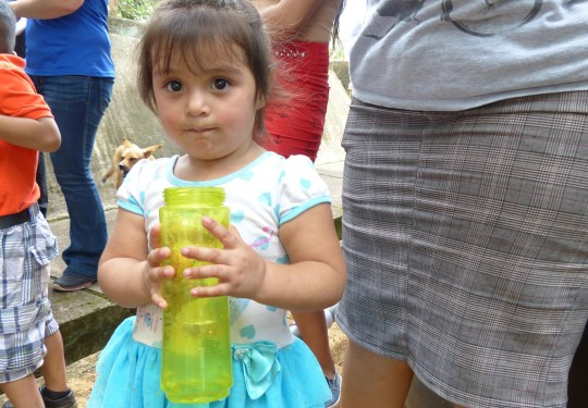 Kids in Los Angeles, Nicaragua, drink from a clean-water system supported by Self-Help International, an Iowa-based non-profit organization.
