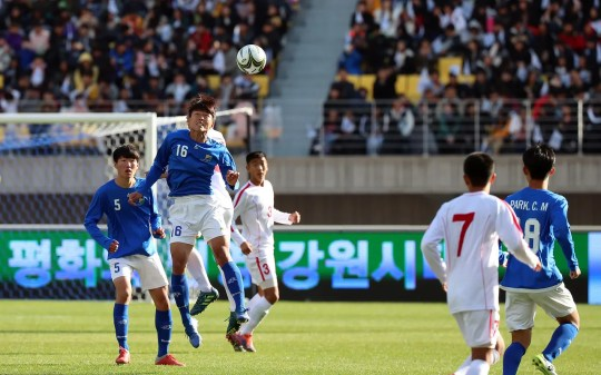 North and South Korean youth soccer teams take the field at the Ari Sports Cup tournament in Chuncheon, South Korea, on Oct. 29.