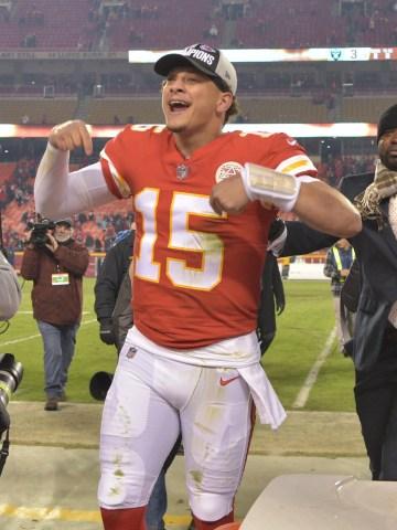 Kansas City Chiefs quarterback Patrick Mahomes (15) celebrates toward the crowd after the win over the Oakland Raiders at Arrowhead Stadium.