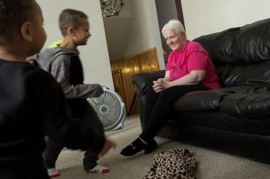 Kim Voelker-Wesley, 41, of Montrose, observes her children Donald Wesley (left), 6 years old, and Cameron Wesley, 3 years old, running around the living room at home on a school holiday in Montrose Thursday, January 3, 2019 . Voelker-Wesley is battling skin cancer that has spread to the breast, lungs and liver after being in remission for five years. The disease has robbed of its livelihood and independence, but not its hopes. Has a resolution of one year: live.