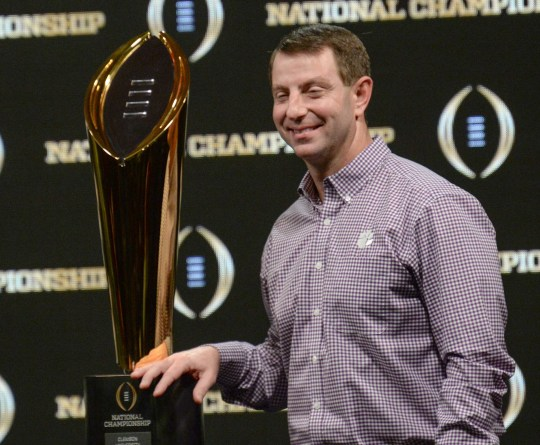 Clemson Head Coach Dabo Swinney stands near the championship trophy during the champions press conference the day after the College Football Championship in San Jose, California Tuesday, January 8, 2019.