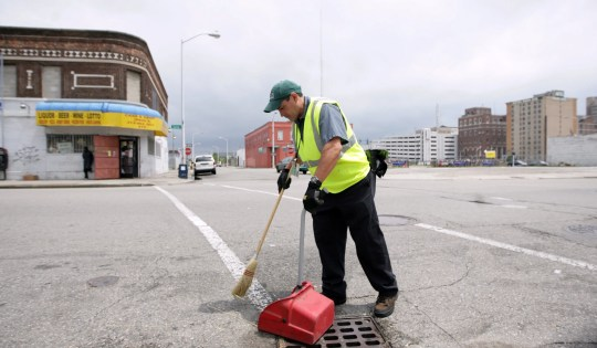 Marc Sandoval of Detroit, who works for Clean Downtown effort, cleans along the streets of Cass and Henry in Detroit on Thursday, July 2, 2009.   RASHAUN RUCKER/Detroit Free Press