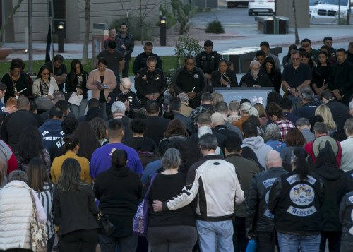 Salt River Police Chief Karl Auerbach (center left, in front of the microphone) leads a vigil in prayer in remembrance of Salt River tribal police Officer Clayton Townsend at Two Waters Courtyard in Scottsdale on Jan. 11, 2019. Townsend was killed while conducting a traffic stop along Loop 101 near Scottsdale.