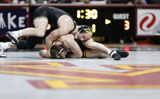 Iowa's Alex Marinelli works on top against Minnesota's Carson Brolsma in a match at 165 pounds on Sunday at the Maturi Pavillion in Minneapolis. Marinelli pinned Brolsma in the third period.