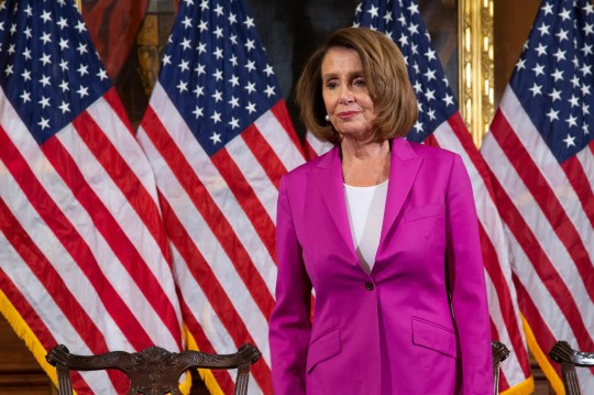 Speaker of the House Nancy Pelosi, D-Calif., waits for her new committee chairs to assemble for a formal photo at the Capitol in Washington Jan. 11, 2019.