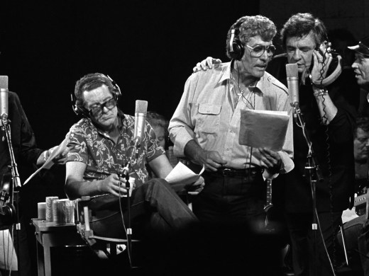 "LEFT to RIGHT:  Roy Orbison, Jerry Lee Lewis, Carl Perkins, Johnny Cash and producer Chips Moman sing during the recording of the ""Class Of 55"" on September 20, 1985.  Moman recorded the reunion album using the four legnedary rock 'n rollers that got their starts in Memphis.  The face between Cash and Moman is lead guitar player Reggie Young.  This scene took place at Moman's old American Recording Studio on North Thomas."