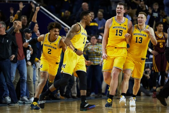 Michigan Wolverines guard Charles Matthews (1) is congratulated by teammates after he hits a game winning basket at the buzzer against the Minnesota Golden Gophers at Crisler Center on Tuesday, Jan. 22, 2019.