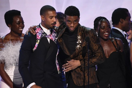 "Danai Gurira (from left), Michael B. Jordan, Chadwick Boseman and Lupita Nyong'o celebrate as the ""Black Panther"" cast accepts the award for outstanding ensemble at the Screen Actors Guild Awards."