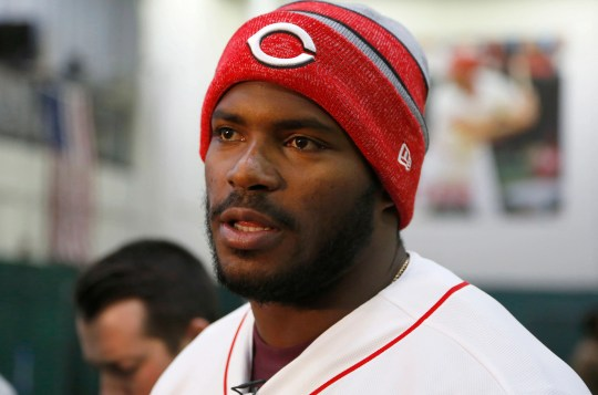 New Reds outfielder Yasiel Puig talks with the media during a visit to the Cincinnati Reds Urban Youth Academy.