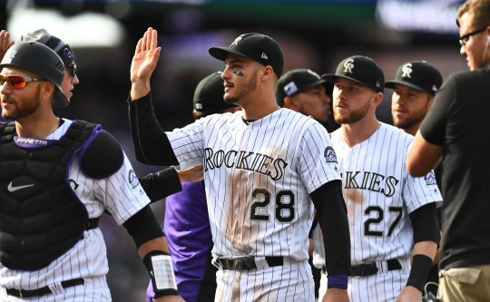 Rockies third baseman Nolan Arenado (28) celebrates after a win over the Nationals at Coors Field.