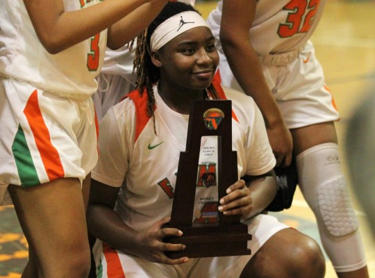 FAMU DRS freshman Ameari Logan and Rattler's Girls' Basketball Team celebrate the title of District 1-3A against NFC 59-41 on January 7, 2019.