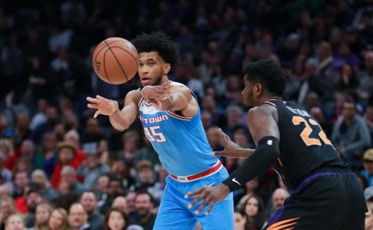 Feb 10, 2019; Sacramento, CA, USA; Sacramento Kings forward Marvin Bagley III (35) passes the ball against Phoenix Suns center Deandre Ayton (22) during the fourth quarter at Golden 1 Center.