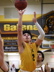 Manogue's Gabe Bansuelo shoots against Galena during Tuesday's game at Galena.