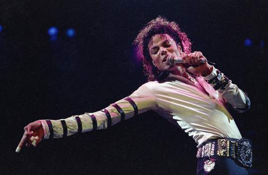 """Michael Jackson performing on his """"Bad"""" world tour in 1988."""