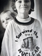 "A child wears an ""I survived the TMI Nuclear Accident"" in an undated photo."