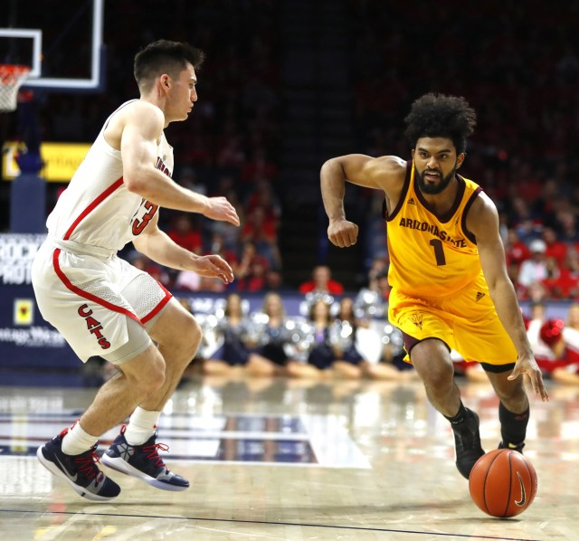 ASU's Remy Martin (1) dribbles against Arizona's Alex Barcello (23) during the second half at the McKale Memorial Center in Tucson, Ariz. on March 9, 2019.