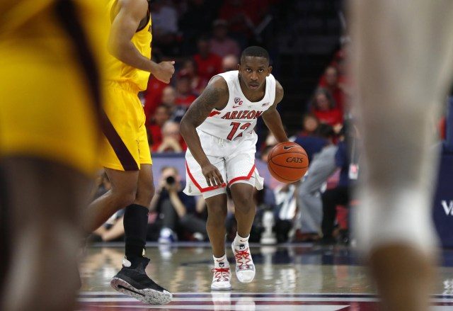 Arizona's Justin Coleman (12) dribbles against ASU's Remy Martin (1) during the first half at the McKale Memorial Center in Tucson, Ariz. on March 9, 2019.