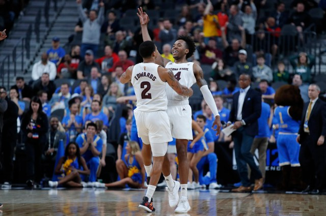 Arizona State's Rob Edwards, left, and Kimani Lawrence celebrate after Lawrence scored a 3-point shot against UCLA during the first half of an NCAA college basketball game in the quarterfinals of the Pac-12 men's tournament Thursday, March 14, 2019, in Las Vegas.