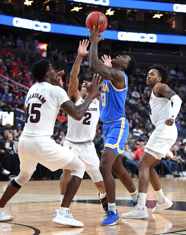 Mar 14, 2019; Las Vegas, NV, United States; UCLA Bruins guard Kris Wilkes (13) reacts to being fouled by Arizona State Sun Devils forward Kimani Lawrence (14) as Arizona State Sun Devils forward Zylan Cheatham (45) and Arizona State Sun Devils guard Rob Edwards (2) defend during the second half of a Pac-12 conference tournament game at T-Mobile Arena.