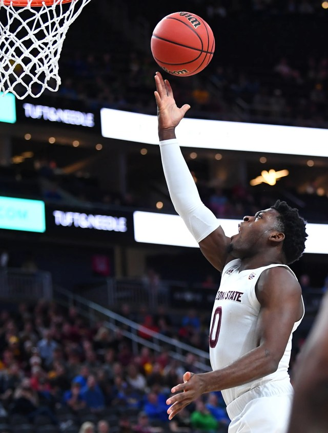 Mar 14, 2019; Las Vegas, NV, United States; Arizona State Sun Devils guard Luguentz Dort (0) shoots during the first half of a Pac-12 conference tournament game against the UCLA Bruins at T-Mobile Arena.