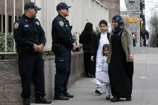 Worshippers arrive for service at the Islamic Cultural Center of New York under increased police security following the shooting in New Zealand, Friday, March 15, 2019, in New York.