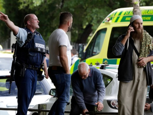 Police attempt to clear people from outside a mosque in central Christchurch, New Zealand.  Multiple people were killed in mass shootings at two mosques full of people attending Friday prayers, as New Zealand police warned people to stay indoors as they tried to determine if more than one gunman was involved.