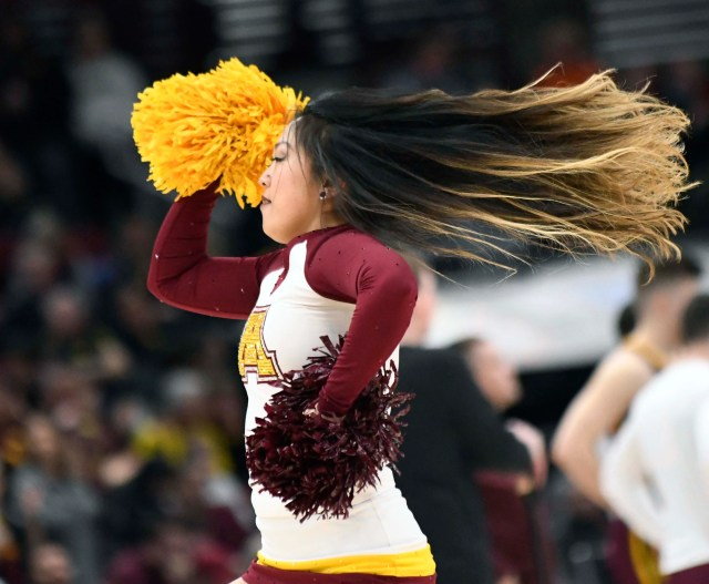Mar 15, 2019; Chicago, IL, USA;  A Minnesota Golden Gophers cheerleader performs during the second half in the Big Ten conference tournament at United Center. Mandatory Credit: David Banks-USA TODAY Sports