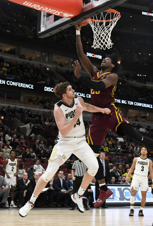 Mar 15, 2019; Chicago, IL, USA; Minnesota Golden Gophers center Daniel Oturu (25) drives to the basket against Purdue Boilermakers guard Ryan Cline (14) during the first half in the Big Ten conference tournament at United Center. Mandatory Credit: David Banks-USA TODAY Sports