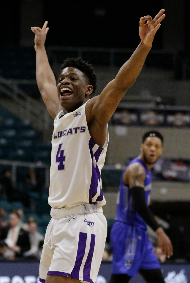 Abilene Christian guard Damien Daniels celebrates a 3-point shot in the final minute of the team's NCAA college basketball game against New Orleans for the Southland Conference men's tournament title Saturday, March 16, 2019, in Katy, Texas.