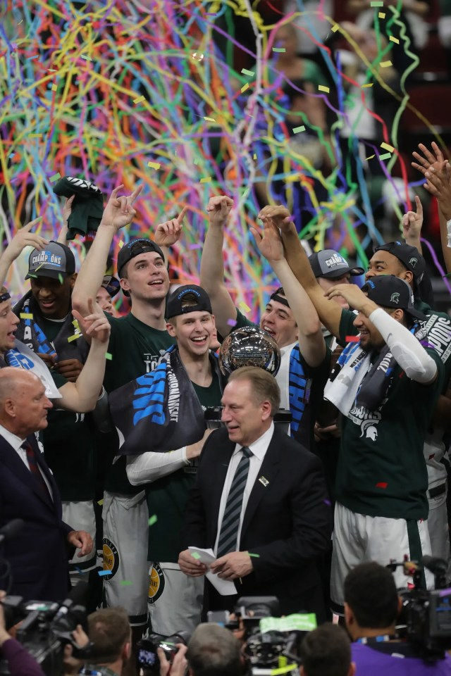 Michigan State accepts the Big Ten tournament championship trophy with confetti falling, after defeating Michigan, 65-60, Sunday, March 17, 2019 at the United Center in Chicago.
