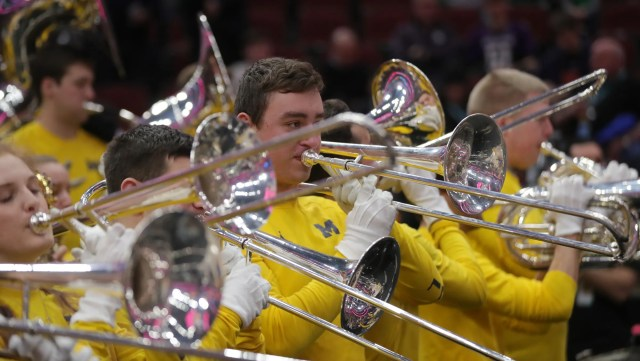 The Michigan band performs before the Big Ten tournament championship against Michigan State, Sunday, March 17, 2019 at the United Center in Chicago.