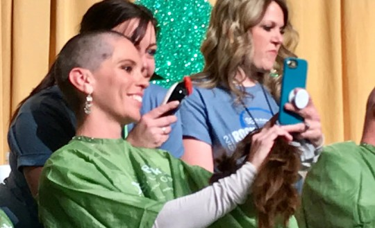 Lindsey Batavia, 40, takes a selfie photo after getting her head shaved at the 14th annual St. Baldrick's Foundation head-shaving event held on March 15, 2019 at the downtown Reno Ballroom.