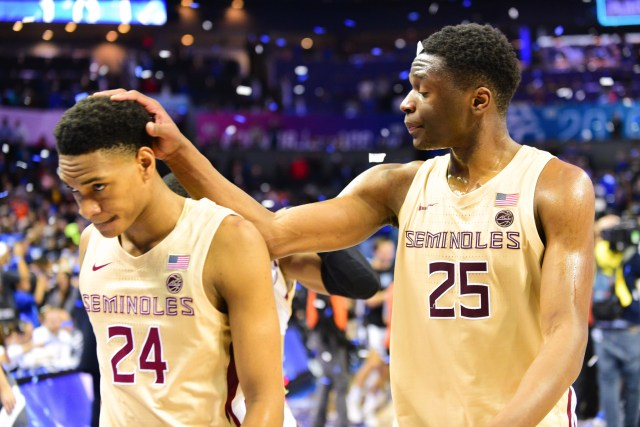 Redshirt sophomore forward Mfiondu Kabengele, 25, comforts freshman forward Devin Vassell, 24, after Florida State's 63-73 lost in the ACC Championship game at the Spectrum Center on Saturday.
