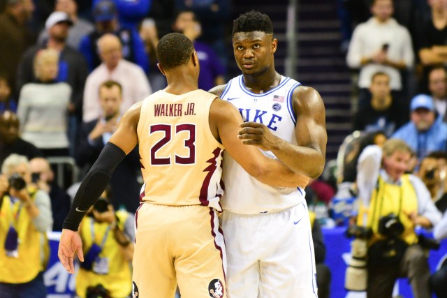 Florida State sophmore guard M.J. Walker, 23, and Duke freshman forward Zion Williamson, right, embrace each other after the Blue Devils defeated the Seminoles 73-63 in the ACC Championship game at the Spectrum Center on Saturday.