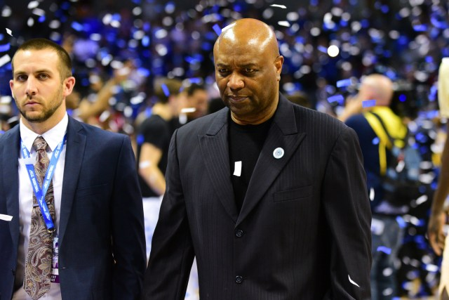 Florida State head coach Leonard Hamilton walks off the court in silence as Duke celebrates its 73-63 win over the Seminoles in the ACC Championship game at the Spectrum Center on Saturday.