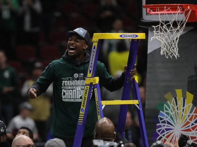 Michigan State guard Joshua Langford cuts the net after the 65-60 win against Michigan in the Big Ten tournament championship Sunday, March 17, 2019 in Chicago.
