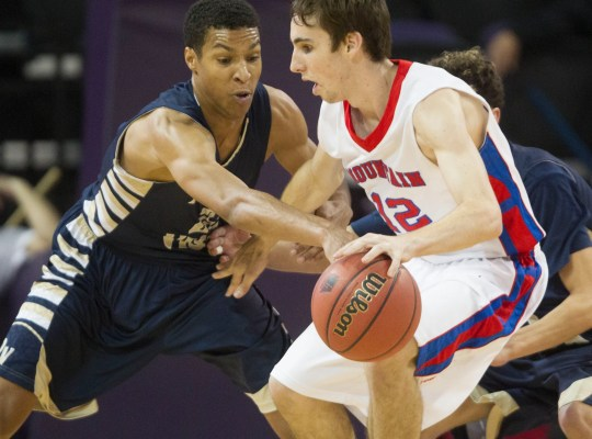 Desert Vista's Brandon Clarke (23) tries to steal the ball away from Mountain View's Tommy Kuhse (12) in the second half at GCU Arena in Phoenix, AZ on February 28, 2015.