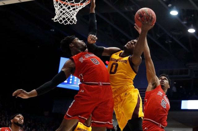 Mar 20, 2019; Dayton, OH, USA; Arizona State Sun Devils guard Luguentz Dort (0) goes to the basket defended by St. John's Red Storm forward Sedee Keita (0) in the first half in the First Four of the 2019 NCAA Tournament at Dayton Arena. Mandatory Credit: Brian Spurlock -USA TODAY Sports