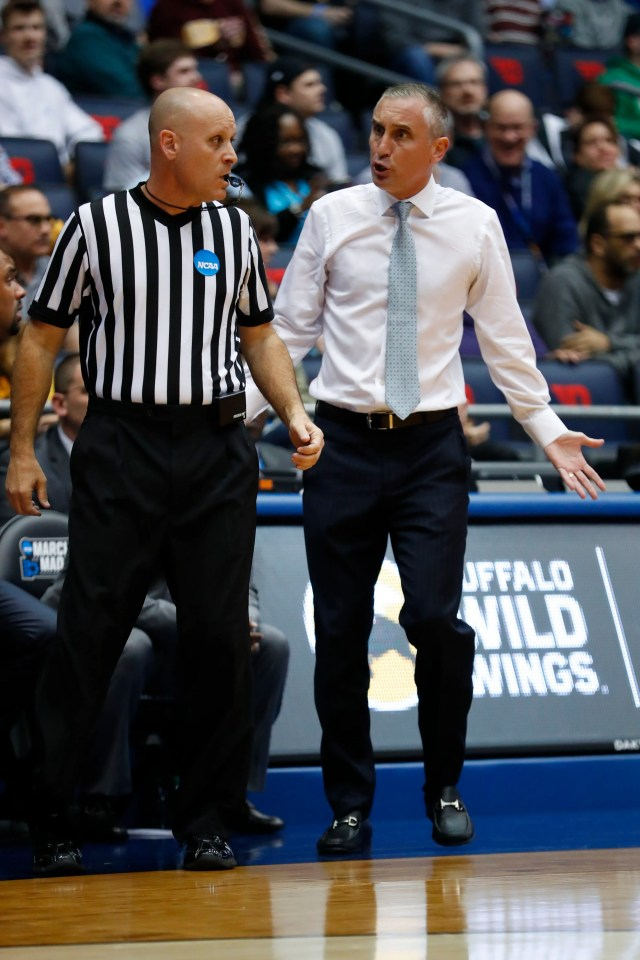 Arizona State University Sun Devils head coach Bobby Hurley talks to an official in the first half against the St. John's Red Storm in the First Four of the 2019 NCAA Tournament at Dayton Arena on March 20, 2019.