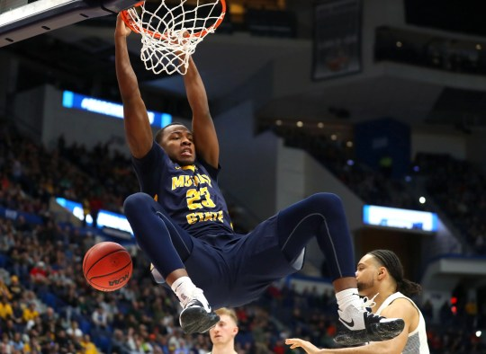 Murray State's KJ Williams dunks vs. Marquette in the NCAA tournament first round.