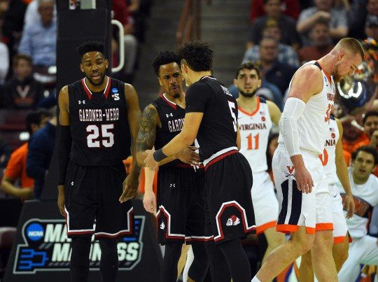 Gardner Webb players huddle during the first half against Virginia in the first round of the 2019 NCAA tournament.