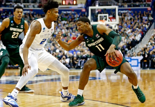 March 31, 2019; Washington, DC, USA; Forward Michigan State Spartans Aaron Henry (11) treats the ball against Duke Blue Devils forward Cam Reddish (2) during the first half of the Eastern Region champion match of the 201AA NCAA Tournament at Capital One Arena. Mandatory Credit: Amber Searls-USA TODAY Sports