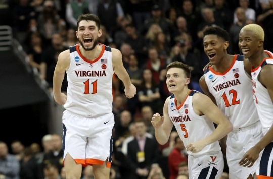 Virginia's Kyle Guy, Mamadi Diakite, Ty Jerome (11) and De'Andre Hunter (12) celebrate as teammate Kihai Clark (not pictured) seals their win with two free throw as the Cavaliers' beat Purdue to reach the Final Four.