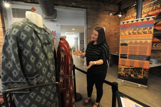 Anne Chesky Smith, director of the Swannanoa Valley Museum and History Center, offers a glimpse of the Beacon Manufacturing exhibit in the first floor gallery of the museum, which will open for the season on April 13.