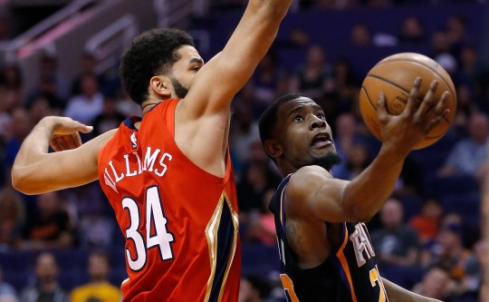 Phoenix Suns forward Josh Jackson drives past New Orleans Pelicans guard Kenrich Williams.