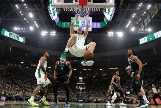 Bucks center Brook Lopez  rises for a slam dunk Sunday night.