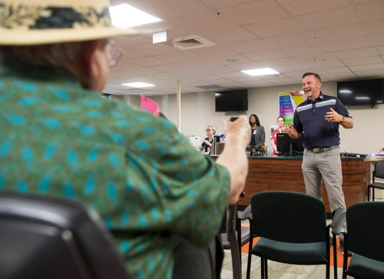 Jason Bohn talks with fellow heart attack survivors at the Normandie Medical Building in Montgomery, Ala., on April 16, 2019.