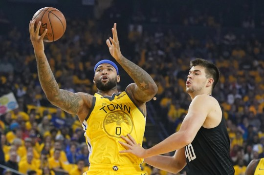 DeMarcus Cousins, left, was injured during Game 2 of the playoffs on Monday night against the L.A.Clippers.